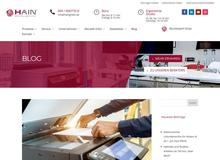 das moderne Büro mit Tisch, Bürodrehstuhl, Kopierer und dms I HAIN GmbH